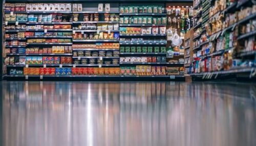 Supermarket aisle with food on shelves