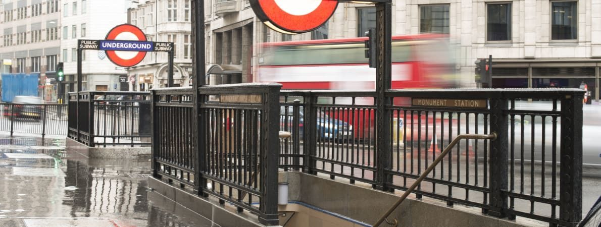 Photo of entrance to London Underground on busy street.