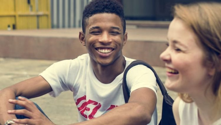 Photo of young people chatting.