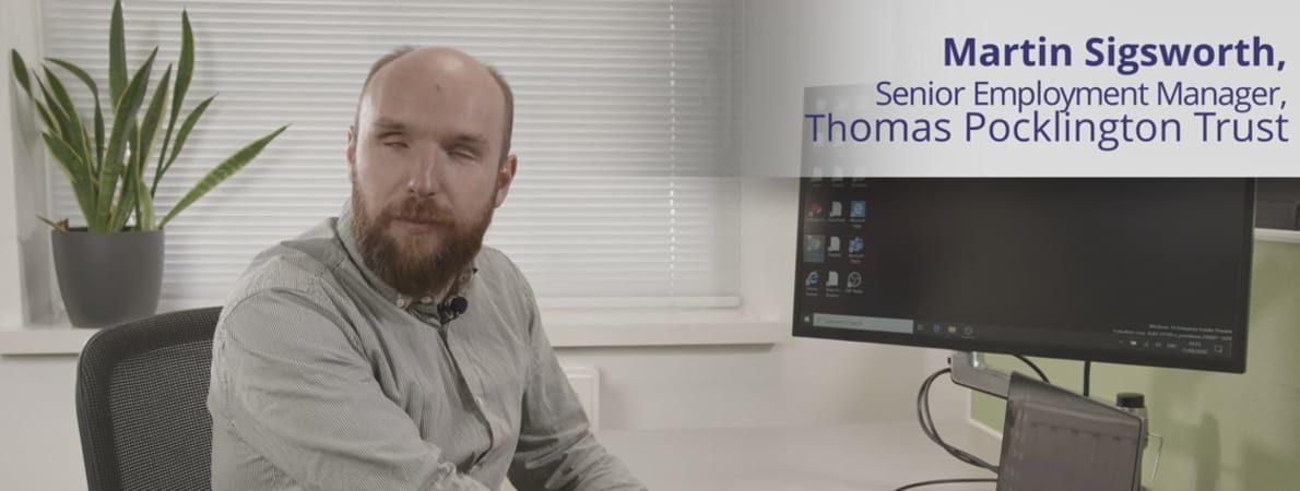 Photo of Martin Sigsworth sat at a computer