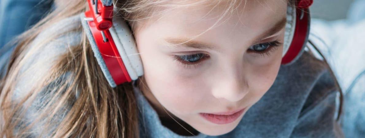 Photo of Young girl wearing headphones