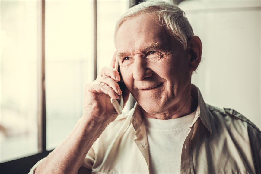 Photo of man on phone smiling