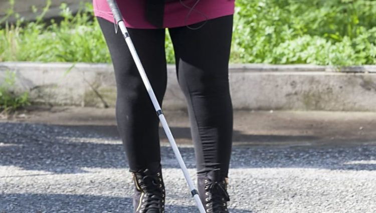 Photo of person using walking cane.