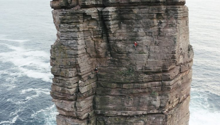 Photo of Jesse Dufton climbing the 'Old Man of Hoy'
