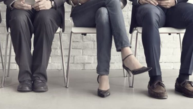 Photo of legs from people queuing for interview