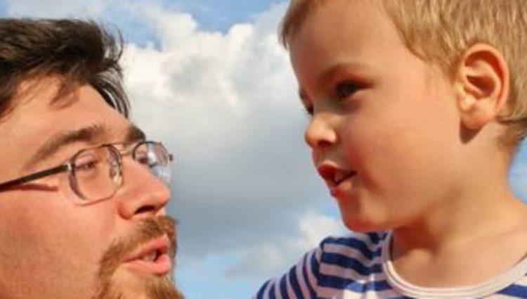 Photo of man holding child