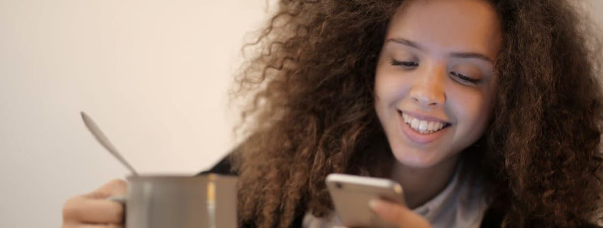 Photo of young woman using phone