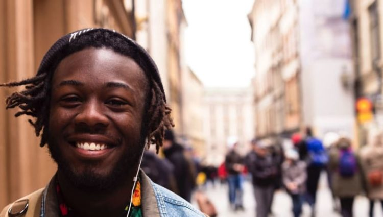 Photo of young person smiling in street