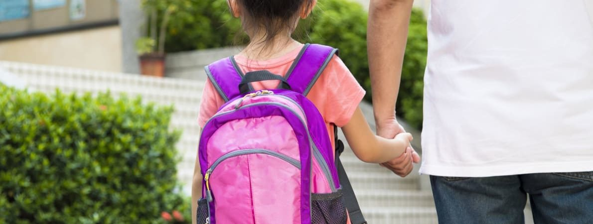 Photo of parent walking child to school