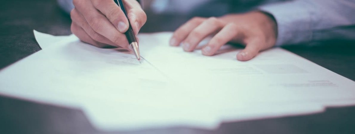 Photo of person writing a covering letter