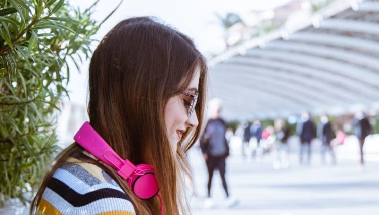 Student on campus smiling
