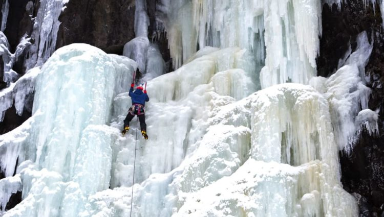 Jesse Dufton climbing an ice fall