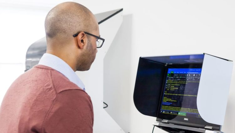 Man working on a computer standing.