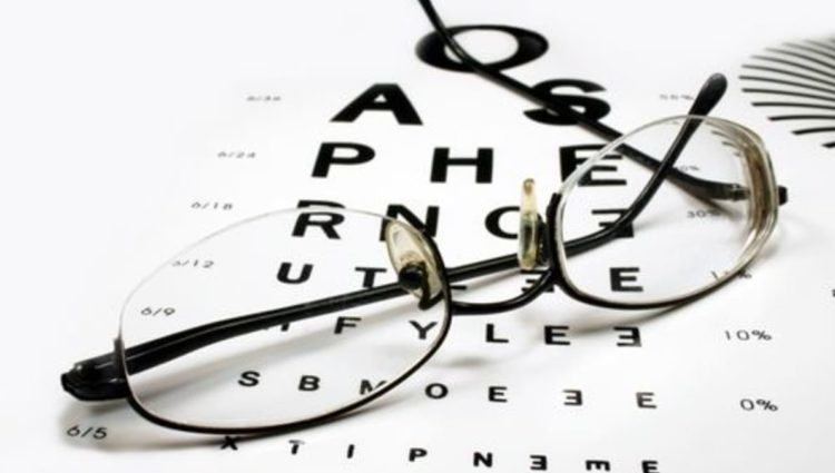Photo of sight chart and glasses