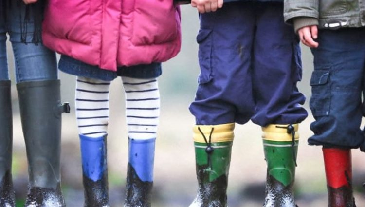 Legs of children with wellies