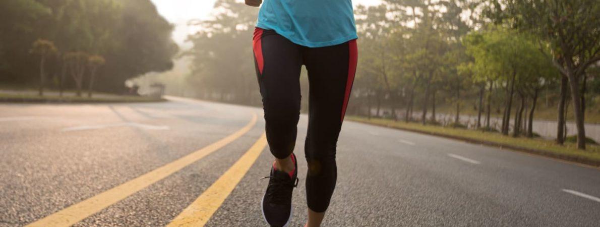 Person jogging alone on road