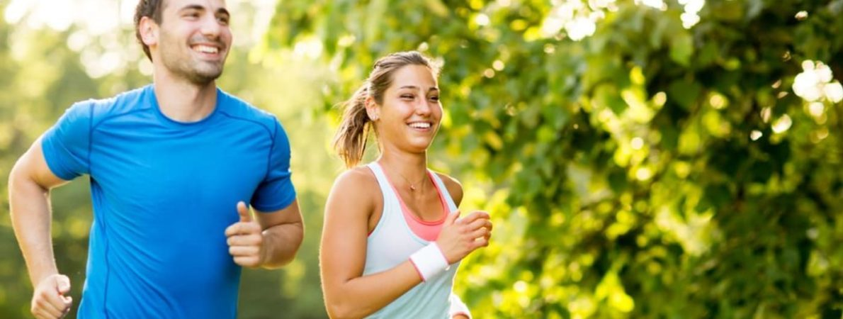 man and woman jogging outdoors on a nice day