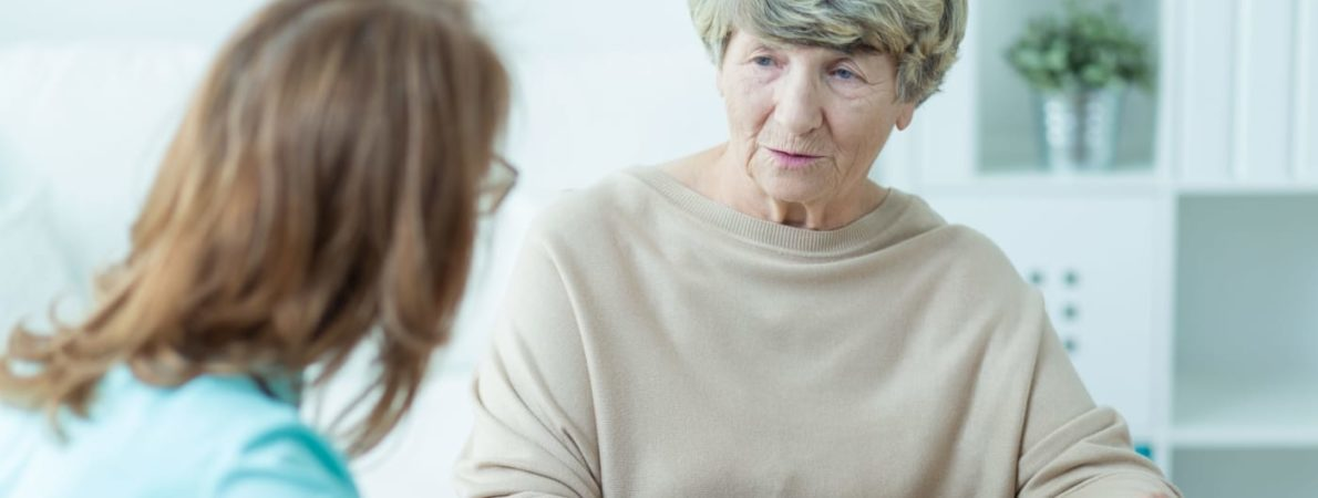older woman talking to younger woman informal setting