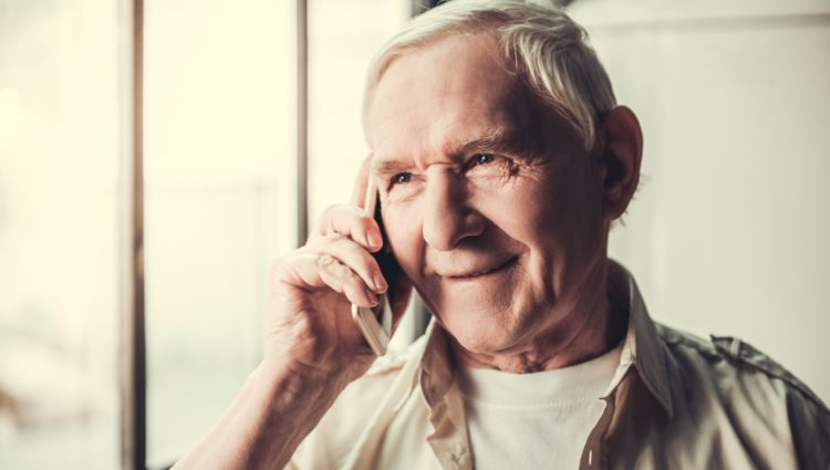 Man smiling speaking on the phone