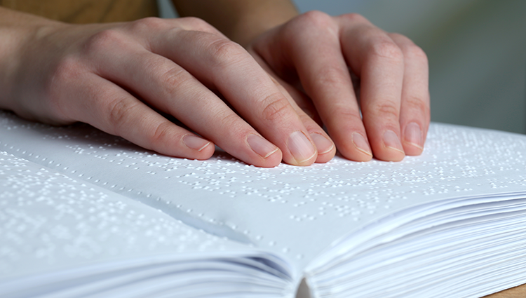 Blind woman reading braille