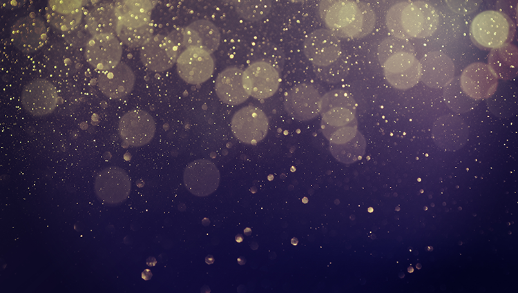 Gold confetti on a black background
