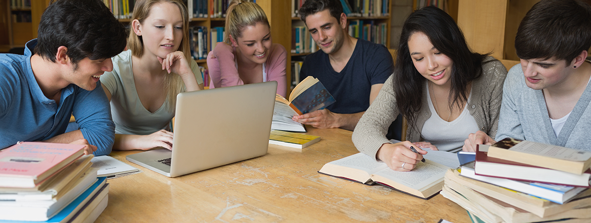 Group of students reading in the library