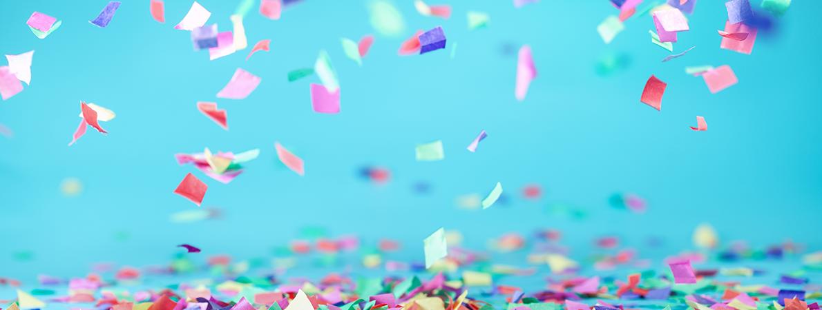 Colored confetti on a blue background