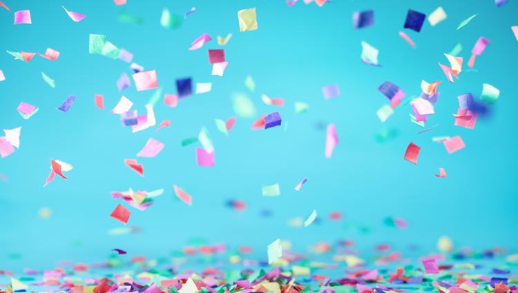 Colored confetti on a blue background