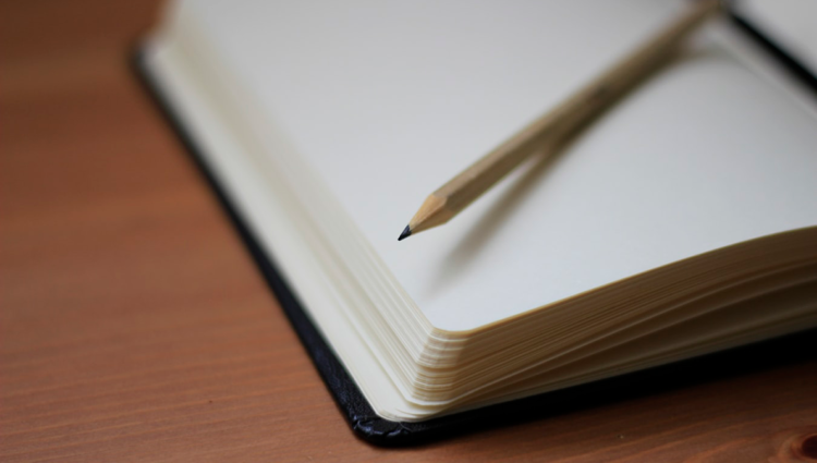 Close up of a pencil and notepad
