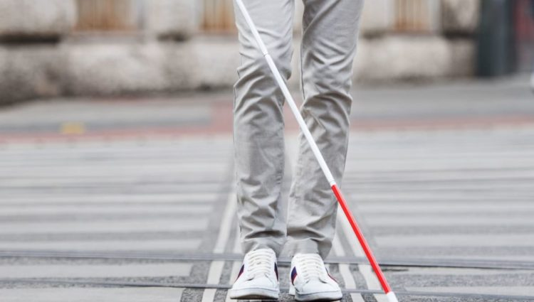 Shot of lower half of man with cane